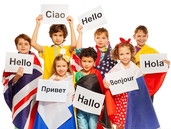 multilingual kids holding signs